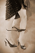 Digitally enhanced image of a A young Caucasian female model of 26 with her Knickers around her ankles only her feet are displayed so there is only a hint to nudity
