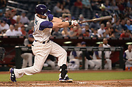 PHOENIX, AZ - APRIL 27:  Chris Owings #16 of the Arizona Diamondbacks hits a solo home run in the third inning against the San Diego Padres at Chase Field on April 27, 2017 in Phoenix, Arizona.  (Photo by Jennifer Stewart/Getty Images)