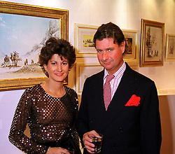 MR & MRS HARRY HOLCROFT he is the artist, at an exhibition in London on 8th November 1999.MYR 9