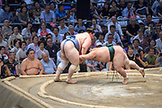 A bout at the Nagoya Summer Grand Sumo Tournament in July 2018.