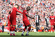 Liverpool forward Sadio Mane (10) celebrates his goal 2-1 with Liverpool forward Roberto Firmino (9)  during the Premier League match between Liverpool and Newcastle United at Anfield, Liverpool, England on 14 September 2019.