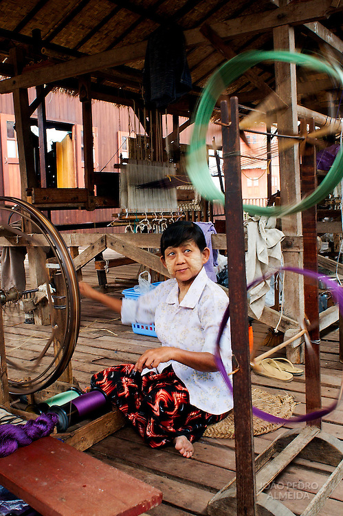 Woman weavin silk at traditional workshop at Inle Lake