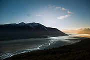 Looking down the Waimakariri river from Bealey Spur as early morning sun highlights the Polar and clearing mist in the river valley.