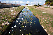 The Sand River canal after a rain. Solid waste runs off from under-serviced areas and runs into the canal and eventually the ocean at Muizenberg.