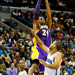 Dec 5, 2012; New Orleans, LA, USA; Los Angeles Lakers shooting guard Kobe Bryant (24) shoots over New Orleans Hornets shooting guard Xavier Henry (4) during the second half of a game at the New Orleans Arena. The Lakers defeated the Hornets 103-87.  Mandatory Credit: Derick E. Hingle-USA TODAY Sports