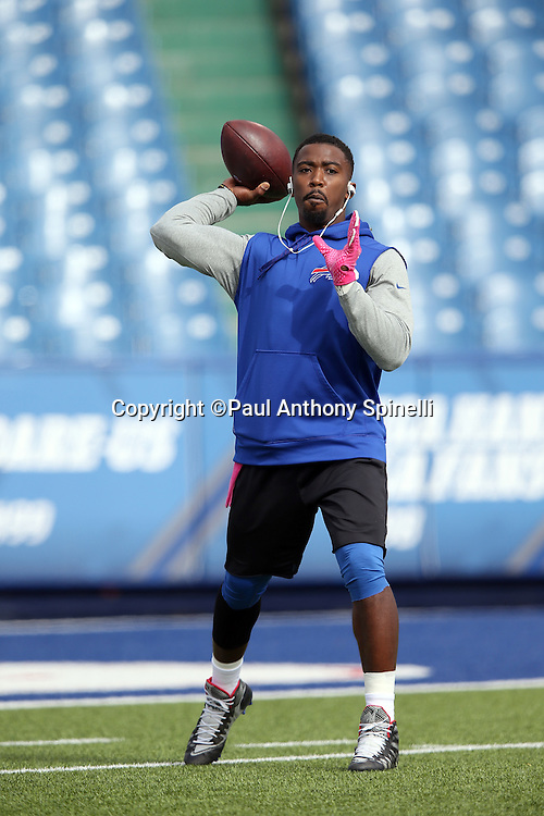 Buffalo Bills quarterback Tyrod Taylor (5) throws a pass while warming up before the 2015 NFL week 4 regular season football game against the New York Giants on Sunday, Oct. 4, 2015 in Orchard Park, N.Y. (©Paul Anthony Spinelli)