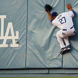Los Angeles Dodgers right fielder Matt Kemp (27) slams into the wall on a Houston Astros' Carlos Lee double in the second inning in Los Angeles, Calif., Wednesday, August 15, 2007, in Los Angeles,Calif. (Pasadena Star-News Keith Birmingham)