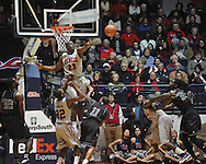 Ole Miss' Reginald Buckner (23) blocks a shot by Texas A&M's J'Mychal Reese (11) in Oxford, Miss. on Wednesday, February 27, 2013. (AP Photo/Oxford Eagle, Bruce Newman)