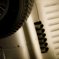 Vintage racing car with exhaust and air vents close up