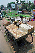 a men selling nuts from a mobile cart, India, Kerala, a state on the tropical coast of south west India