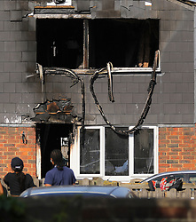 """© Licensed to London News Pictures. 07/08/2018. London, UK. Fire damage to a window at the scene of a house fire in Deptford, east London, in which a 7 year-old boy has died. Six fire engines were called to a """"suspicious"""" fire in the early hours of Tuesday morning. Photo credit: Rob Pinney/LNP"""