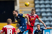 10th August 2019; Dens Park, Dundee, Scotland; SPFL Championship football, Dundee FC versus Ayr; Jamie Ness of Dundee competes in the air with Andy Geggan of Ayr United