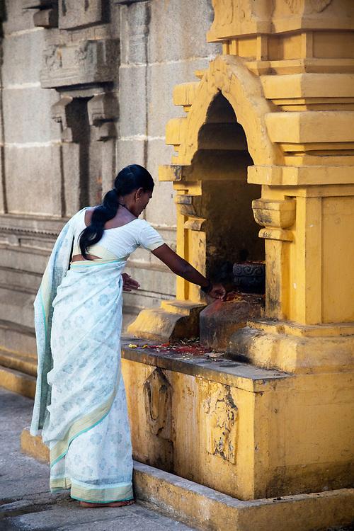 KADIRI, INDIA - 03rd November 2019 - Hindu woman praying at a shrine in Kadiri temple, Andhra Pradesh, South India.