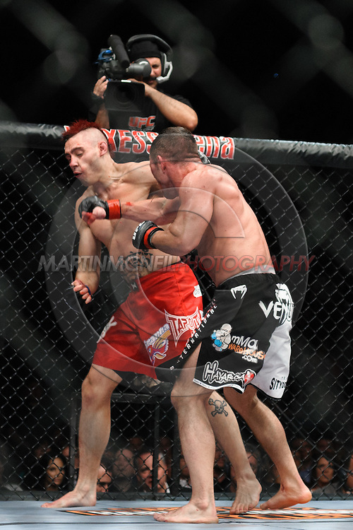"COLOGNE, GERMANY, JUNE 13, 2009: Dan Hardy and Marcus Davis during ""UFC 99: The Comeback"" inside LanXess Arena, Cologne"
