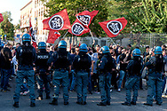 ROME, ITALY - SEPTEMBER 13: ROME, ITALY - SEPTEMBER 13: Police create a barrier to control Casapound's extreme right-wing supporters who clashed with with the anti-fascists in front of the Fourth Town Hall, where the future of a centre for refugees was discussed on September 13, 2017 in Rome, Italy. Far right movement Casapound are demanding the closure of the centre which is run by the Red Cross in District Tiburtino IV in Rome.  (Photo by Stefano Montesi )