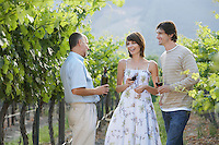 People drinking wine in vineyard