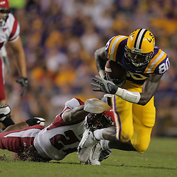 19 September 2009: LSU Tigers wide receiver Terrance Toliver (80) is grabbed by Louisiana-Lafayette Cajuns safety Phillip Nevels (24) during 31-3 win by the LSU Tigers over the University of Louisiana Lafayette Ragin' Cajuns at Tiger Stadium in Baton Rouge, Louisiana.