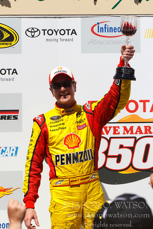 June 26, 2011; Sonoma, CA, USA;  NASCAR Sprint Cup Series driver Kurt Busch (22) celebrates in the winners circle after winning the Toyota/Save Mart 350 at Infineon Raceway.