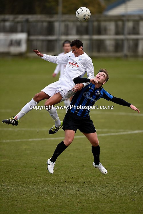 Noah Billingsly (Top) of Western Suburbs jumps for the ball with Ben Thomas of Miramar during the Miramar Rangers AFC v Western Suburbs soccer match at David Farrington Park in Wellington on Monday the 02 June 2014. Photo: Marty Melville/www.photosport.co.nz