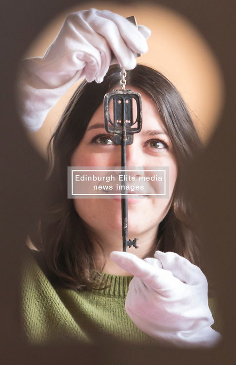 Lyon & Turnbull are auctioning the key used to open the Glasgow School of Art in 1899. The key, which will be sold on April 11, has not been seen in public since the school's opening ceremony.<br /> <br /> Pictured: Charlotte Riordan, Specialist at Lyon &Turnbull holding the Glasgow School of Art key