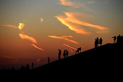 © Licensed to London News Pictures. 16/03/2014. London, England. People enjoy the sunset at Northala Fields, West London. Photo credit : Mike King/LNP