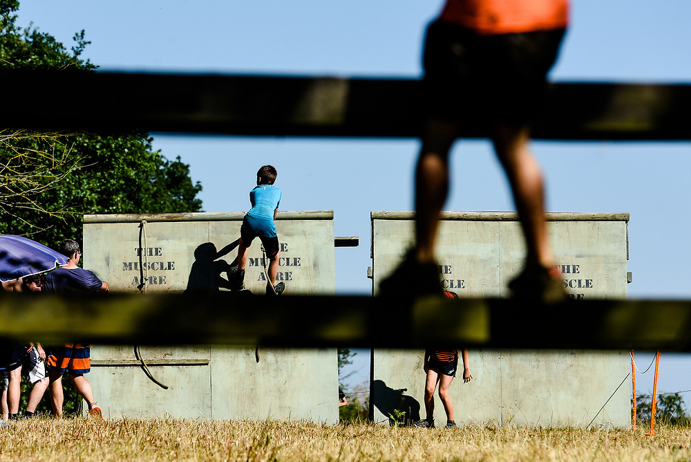 The Muscle Acre, Wood Street, Guildford, Surrey Picture date: Sunday July 15, 2018. Photo credit should read: Dan Law.<br /> <br /> The Muscle Acre is an obstacle race series based in Guildford, Surrey. Established in November 2014, Muscle Acre comprises of three events throughout the year: the Winter Warmer in February, the Summer Madness in July and the Mud Slog in November. Muscle Acre attracts a diverse audience, from fun-runners and charity fundraisers to competitive OCR runners.