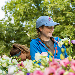A woman arranges freshly picked flowers at Barker's Farm in Stratham, New Hampshire.