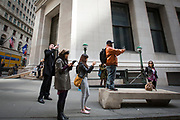 Tourists taking pictures of the NYSE Euronext Stock Exchange on Wall Street.