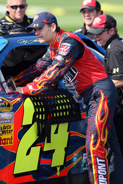 September 26, 2008; Kansas City, KS, USA; Jeff Gordon pushes his car with teammates prior to qualifying for the Camping World RV 400 at Kansas Speedway. Mandatory Credit: Douglas Jones-US PRESSWIRE