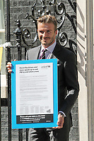 LONDON - JULY 26: Footballer and UNICEF Goodwill Ambassador David Beckham met with Prime Minister David Cameron to ask him to take immediate action to tackle child malnutrition worldwide, Downing Street, London, UK. July 26, 2012. (Photo by Richard Goldschmidt)