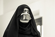 Metal faceplates are worn by some women in addition to the niqab and abaya, used to hide cheeks and nose in Dubai, United Arab Emirates. 2012. (photo by Anuska Sampedro Carballeira)