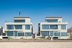 Luxury modern villas facing onto beach in Dubai United Arab Emirates