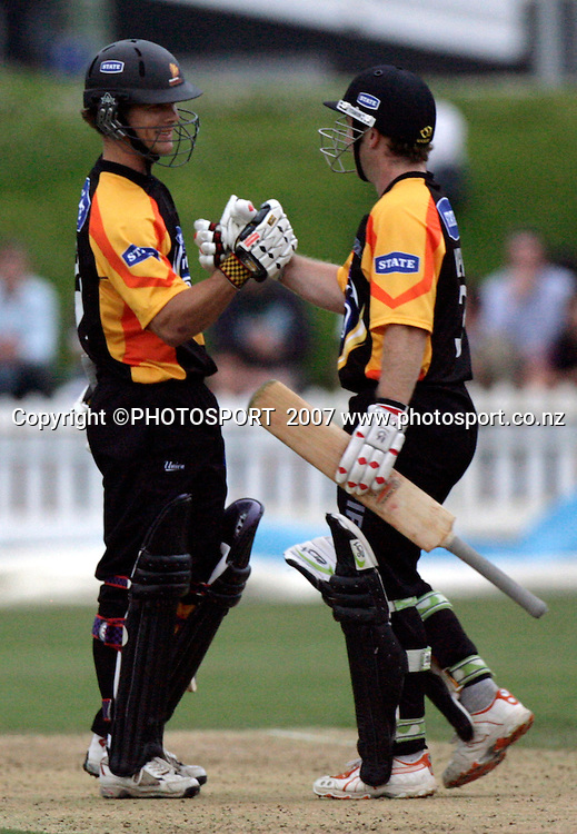 The Firebirds' Stuart Mills and Chris Nevin (R) celebrate their win in Twenty20 cricket action between the Central Stags and Wellington Firebirds at the Basin Reserve, Wellington, Friday 26 January, 2007.    Photo:  Anthony Phelps/PHOTOSPORT
