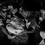 Philippines, Mindanao. Davao Oriental 2012. Distribution of food and goods.