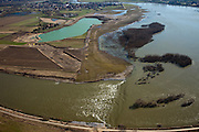 Nederland, Limburg, gemeente Stein, 07-03-2010; Meers, werkzaamheden in het kader van het project Grensmaas. Rechts en onder in beeld de Maas met verbreedde stroomgeul, de gegraven plas gaat dienen als gronddepot. Grensmaas project is een samenspel van rivierbeveiliging door stroomgeulverbreding en oeververlaging, natuurontwikkeling en ontgrinding..Meers, work under the project Meuse. Right and botto,  the river with widened stream channel, the dug lake will serve as the soil depot. Grensmaas (Border Meuse) project is a combination of security by stream channel widening and bank reduction, habitat developemnet and 'de-gravelisation').luchtfoto (toeslag), aerial photo (additional fee required).foto/photo Siebe Swart