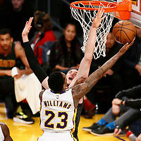27 November 2016: Los Angeles Lakers guard Louis Williams (23) goes for the layup over Atlanta Hawks forward Mike Muscala (31) during the Los Angeles Lakers 109-94 victory over the Atlanta Hawks, at the Staples Center, Los Angeles, California, USA.