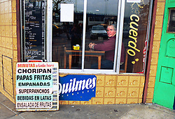 BUENOS AIRES, ARGENTINA:  A man looks out the window of a diner in Buenos Aires, Argentina. (Photo by Ami Vitale)