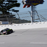 Kurt Busch (41) brings his car through the turn 4 during practice for the 1000Bulbs.com 500 at Talladega Superspeedway in Talladega, Alabama.