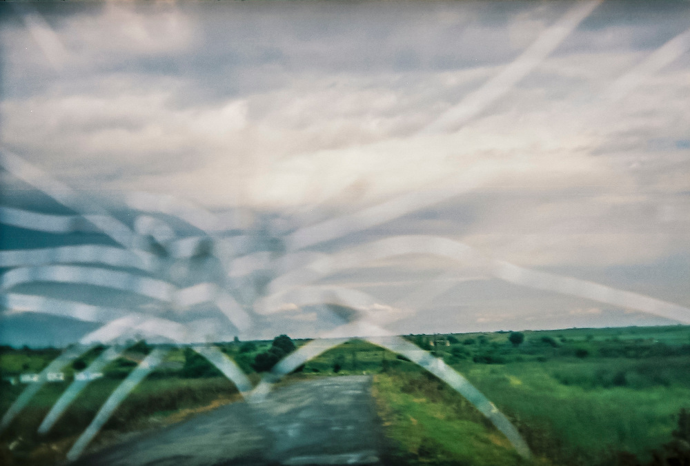 The road en route to the front line is seen through a cracked windshield on Sunday, May 8, 2016 in Talish, Nagorno-Karabakh.