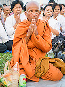 "31 JANUARY 2013 - PHNOM PENH, CAMBODIA:  Buddhist monks lead a prayer service for former King Norodom Sihanouk in front of the Royal Palace in Phnom Penh. Norodom Sihanouk (31 October 1922 - 15 October 2012) was the King of Cambodia from 1941 to 1955 and again from 1993 to 2004. He was the effective ruler of Cambodia from 1953 to 1970. After his second abdication in 2004, he was given the honorific of ""The King-Father of Cambodia."" Sihanouk served two terms as king, two as sovereign prince, one as president, two as prime minister, as well as numerous positions as leader of various governments-in-exile. He served as puppet head of state for the Khmer Rouge government in 1975-1976. Most of these positions were only honorific, including the last position as constitutional king of Cambodia. Sihanouk's actual period of effective rule over Cambodia was from 9 November 1953, when Cambodia gained its independence from France, until 18 March 1970, when General Lon Nol and the National Assembly deposed him. Upon his final abdication, the Cambodian throne council appointed Norodom Sihamoni, one of Sihanouk's sons, as the new king. Sihanouk died in Beijing, China, where he was receiving medical care, on Oct. 15, 2012. His funeral procession, which will wind through Phnom Penh is Friday, Feb.1 and his cremation is on Feb. 4, 2013. Over a million people are expected to attend the service.    PHOTO BY JACK KURTZ"