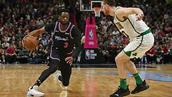 January 11, 2019 - Miami, FL, USA - El defensa del Heat Dwyane Wade (3) lleva el balón frente al delantero de los Celtics Gordon Hayward (20) este jueves en el American Airlines Arena. (Credit Image: © David Santiago/Miami Herald/TNS via ZUMA Wire)