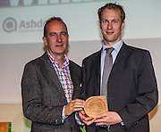 Kevin McCloud, author, broadcaster and designer presenting Neil Jennings of Student Switch OFF with an Ashden award. The 2012 Ashden Awards for sustainable energy ceremony at the Royal Geographical Society. London.