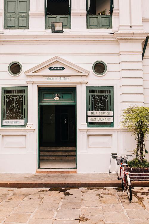 Resaurant doorway within the walls of the old royal palace, Bangkok