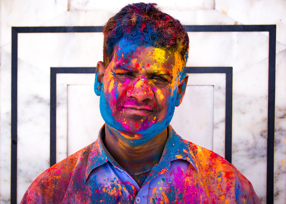A hindu man covered with paint during the colorful Holi-festival (Jaipur, India, 2011).<br />