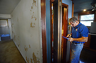 Home inspector Frank Castiglione of Real Estate Inspections, checks out the heater area as he looks at a home for possible problems Thursday, September 28, 2017 in Plymouth Meeting, Pennsylvania. (WILLIAM THOMAS CAIN / For The Philadelphia Inquirer)