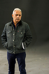 "Pictured: Hanif Kureishi, CBE is a British playwright, screenwriter, filmmaker and novelist of Pakistani and English descent. In 2008, The Times included Kureishi in their list of ""The 50 greatest British writers since 1945""<br /> <br /> Book fanatics headed to Charlotte Square in Edinburgh which is the hub of the international Book Festival to meet the authors and also to meet up with fellow fans of the printed word.<br /> <br /> <br /> Ger Harley 