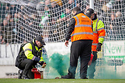 Stewards deal with a smoke canister that's thrown onto the field during the Ladbrokes Scottish Premiership match between St Johnstone and Celtic FC at McDiarmid Park, Perth, Scotland on 3 February 2019.