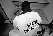 State prisoner studies an English textbook at a correctional facility in Georgia.
