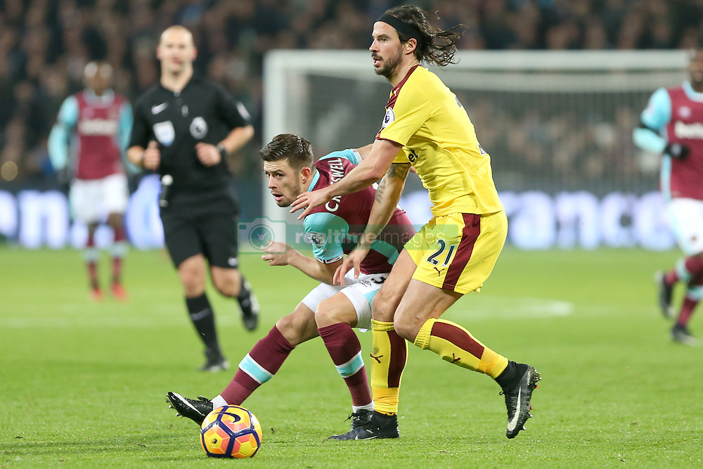 14 December 2016 - Premier League Football - West Ham United v Burnley<br /> Aaron Cresswell of West Ham and George Boyd of Burnley battle for the ball<br /> Photo: Charlotte Wilson