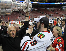 June 9, 2010; Philiadelphia, PA; USA;  Chicago Blackhawks center Jonathan Toews (19) celebrates with family after the Blackhawks defeated the Flyers 4-3 in Game 6 of the Stanley Cup Finals at the Wachovia Center.
